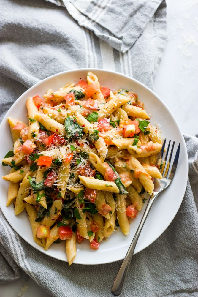 Made with fresh tomatoes, milk, and neufchatel cheese. This fresh tomato cream sauce is tossed with hot penne for an easy, light, and meatless meal.