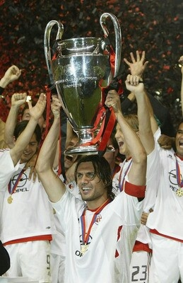 Paolo Maldini lifting the european cup in 2003 , 40 years after his father's achievement in 1963