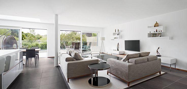 Living room : Modern living room by Baufritz (UK) Ltd.