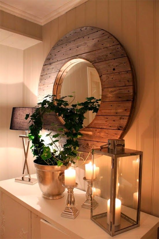 espelho com carretel de madeira Mais