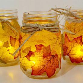 How to decoupage leaves onto mason jars to create cute Fall decor.  Do I see a centerpiece idea?