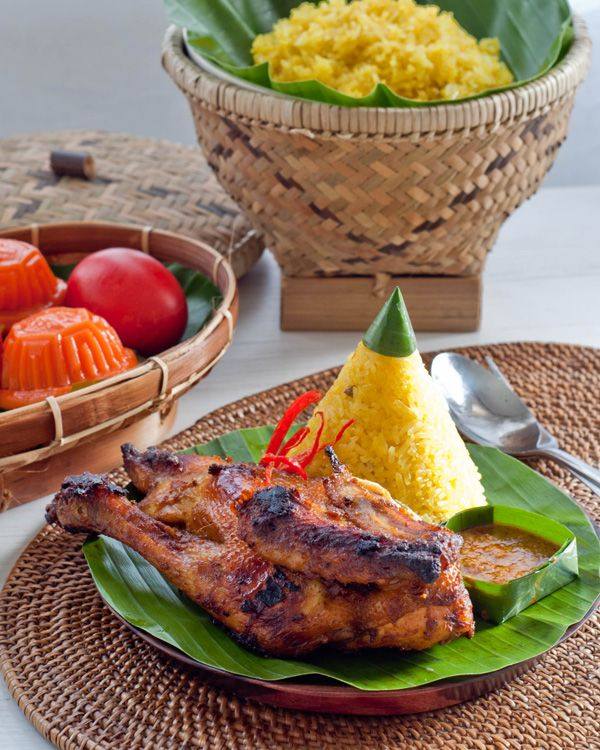 Indonesian yellow rice with grilled chicken