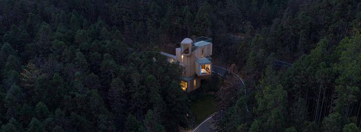 Hotel casa sull'albero di Bengo in studio in Cina comprende una serie di volumi di legname impilati
