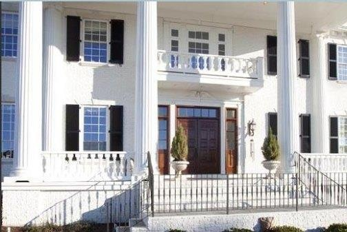 GREEK REVIVAL ~ Horizontal Transom The horizontal transom sits over the front door, instead of a fanlight like the earlier Federal period homes.