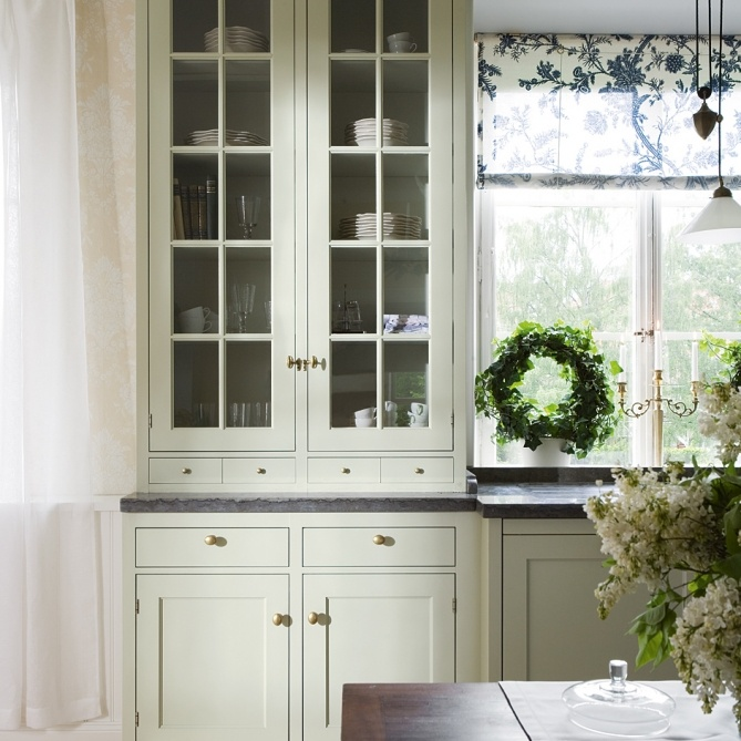 Kvanum cabinets with glass windows, knobs in antique brass , grey limestone counters, etc.
