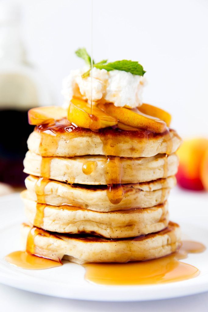 Bourbon Peach Pancakes topped with bourbon-soaked peaches make for the perfect weekend breakfast!