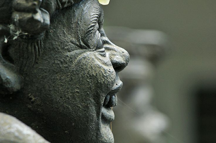 Laughing statue