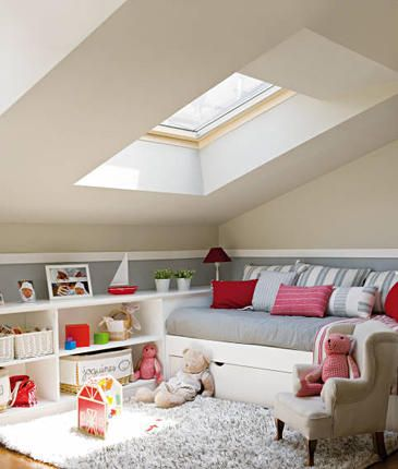 Cozy Attic playroom.  built-in storage + daybed + shag rug + skylight