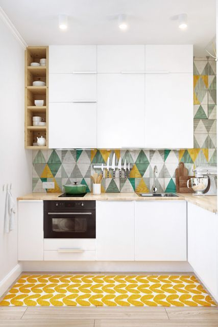 This Tiny Studio Is Cleverly Divided Into 4 Functional Areas #refinery29 http://www.refinery29.com/living-in-a-shoebox/6#slide-4 Geometric patterns can be found throughout the apartment, including in the kitchen, where the bright yellow and greens really open it all up.Related: How To Maximize Your Cabinet Space