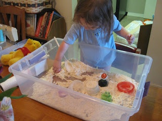 """DIY Indoor Sandbox: Mix 4 cups flour with 1/2 cup oil, put mixture in shallow bin, add toys and small containers and spoons for """"sand"""" play!"""