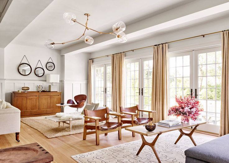 gorgeous french doors and tons of light in this warm open living room | pilar guzman house tour via coco kelley