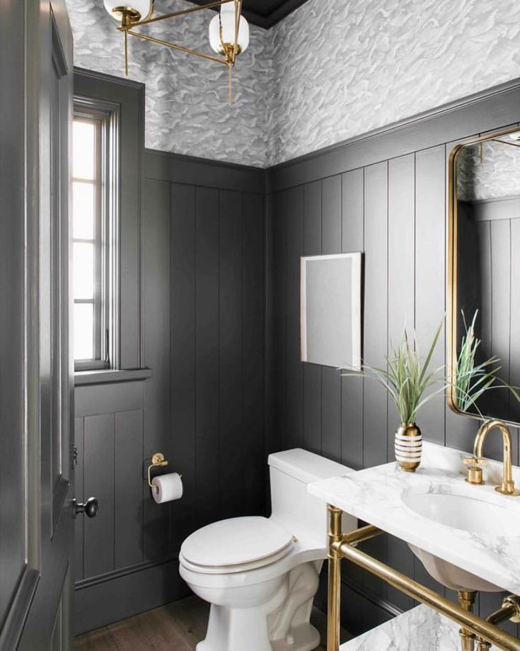 Decadent powder room with wide vertical shiplap an…