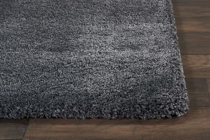CK700 Charcoal This Greenpoint area rug by Calvin Klein