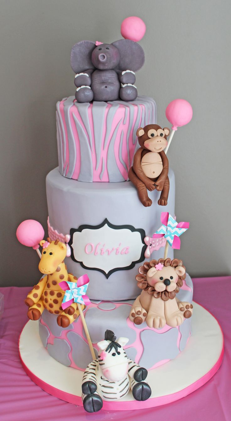 Girly Safari First Birthday Cake - A cake for a first birthday. The middle tier is an 8 inch tier. It was the first time I did an extended tier and the fondant was draped over. Besides the monkey, the fondant animals were a first as well.