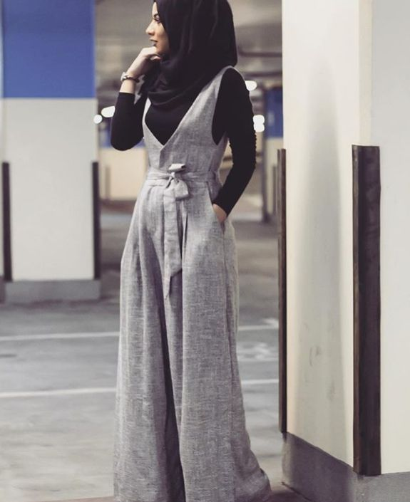 Grey jumpsuit, black shirt, black scarf, watch-Hijab Fashion