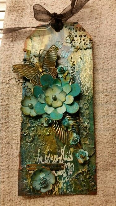 Tag. Using stencils with heavy gel, silks painting and glitter for background.