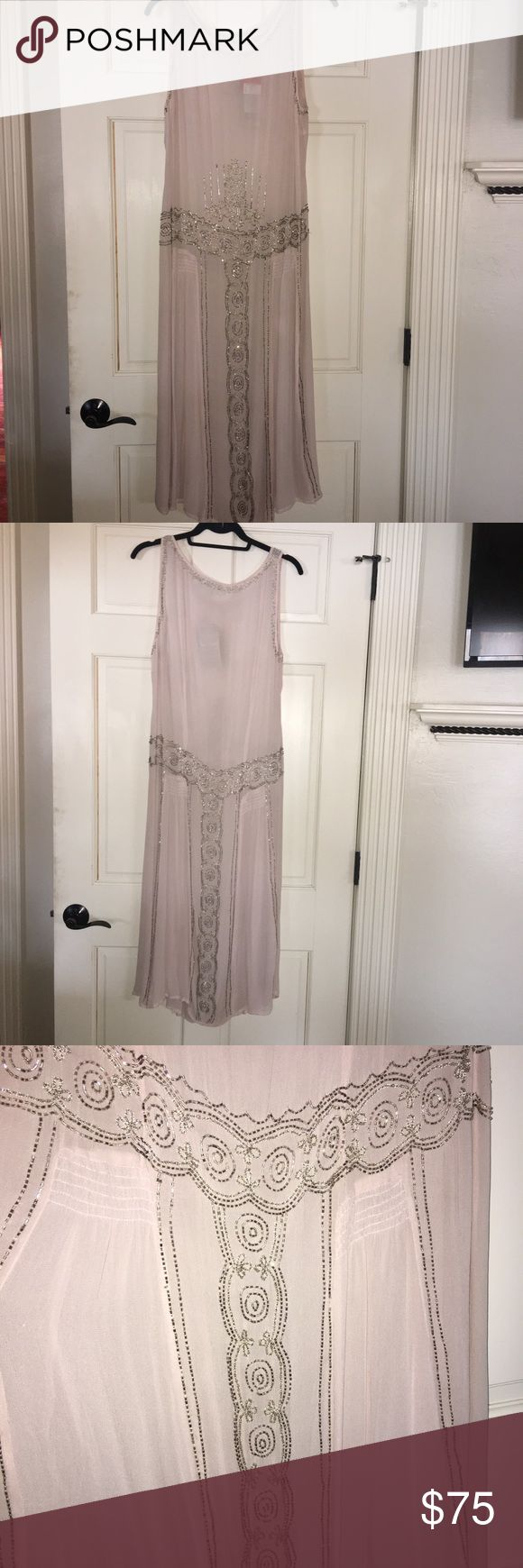 NWT Antique Georgette for Noa Noa Dress New With Tags Antique Georgette for Noa Noa light pink dress with silver beading. ***This price is firm*** This dress comes with a slip so it's not see-through. Never worn. I bought this dress at a boutique in Rome, Italy. Noa Noa is a feminine Scandinavian clothing brand for women & and kids. Noa Noa Dresses