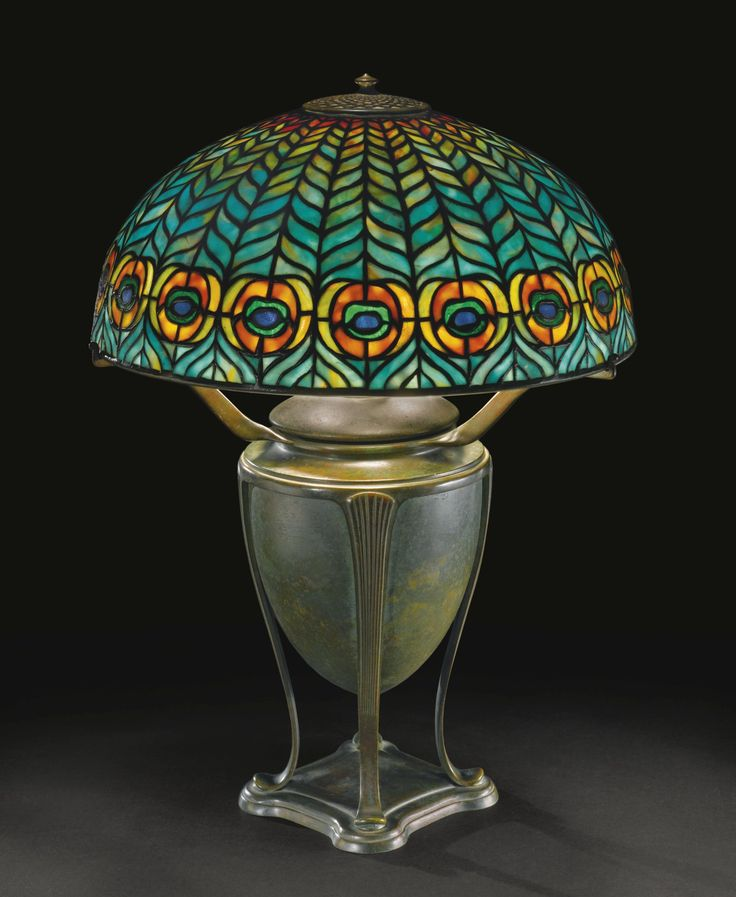 """TIFFANY STUDIOS """"PEACOCK"""" TABLE LAMP, circa 1904 - with a """"Greek"""" base shade impressed TIFFANY STUDIOS NEW YORK 1464-3 base impressed TIFFANY STUDIOS/NEW YORK/181 leaded glass and patinated bronze 20  3/4  in. (52.7 cm) high 15  7/8  in. (40.3 cm) diameter of shade circa 1904"""