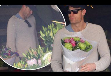 Dr Chris Brown purchases pink roses at Bondi after confirming romance