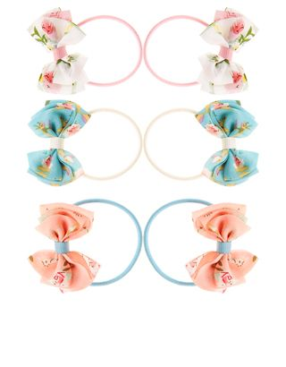 This set of six elasticated hairbands for girls is decorated with loopy printed bows – a perfect way to dress up her locks. Warning! Not suitable for childre...