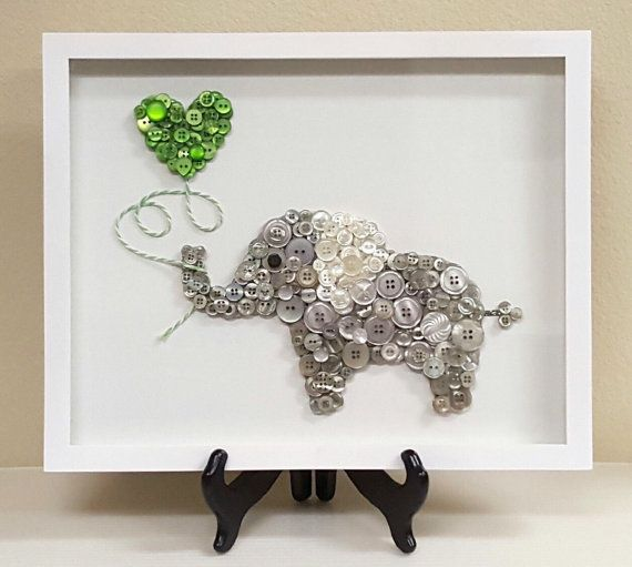 The Elephant Jungle Animal series features a heart shaped balloon to express love. Each beautifully made custom piece comes framed on a 11 x 14 white canvas. This unique piece of decor will add a special design touch to any nursery or childs room. Great gifts for baby showers, expecting parents, childrens birthdays, or just because!  A variety of button colors and images are available. Please email me to discuss a piece we can create just for you! Once we have designed a custom order, I will…