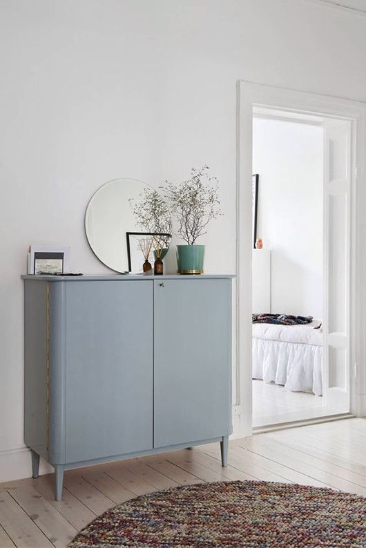 blue vintage cabinet in white hallway / sfgirlbybay