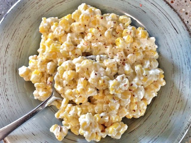 Easy Cream Cheese Corn--1 can whole kernel sweet corn - 4 oz cream cheese - 4 tbsp butter - salt, pepper, and red pepper flakes to taste