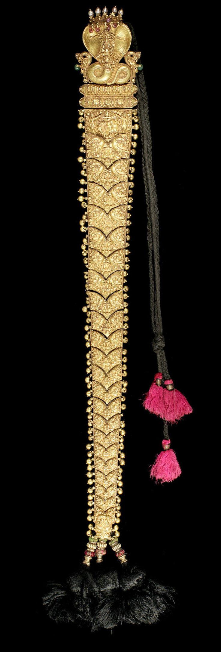 A ruby, emerald and pearl-set repousse gold Hair Braid Ornament (Jadai Nagam)  Tamil Nadu, 19th Century with five-headed cobra fitting to top, sheet gold, filled with lac  62 cm. long approx.