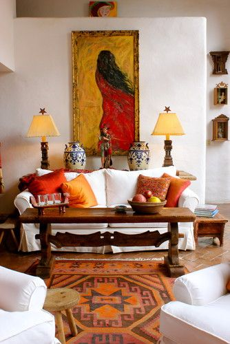 Carole Meyer - Perfect color pickup in art, rug, cushions, lamps...warm and inviting bouncing off white.