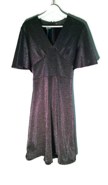 Check out this item in my Etsy shop https://www.etsy.com/listing/484525376/vintage-80s-dress-silver-metallic-dress