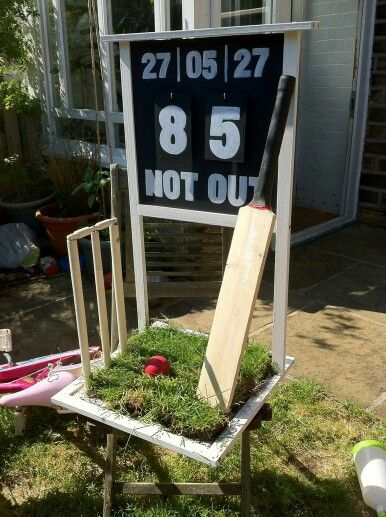 A cricket-themed chalkboard, used as a garden ornament, for a birthday gift!