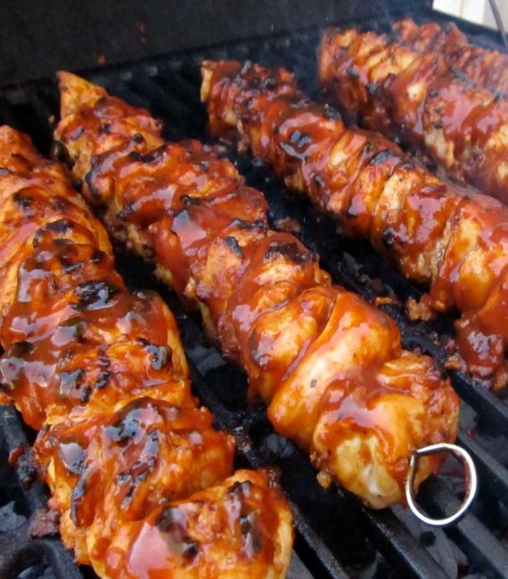 Recipe for BBQ Chicken Bacon Skewers - Grilling the skewers with the bacon in between the chick caused everything to fuse together creating these delicious bites of BBQ chicken and bacon.