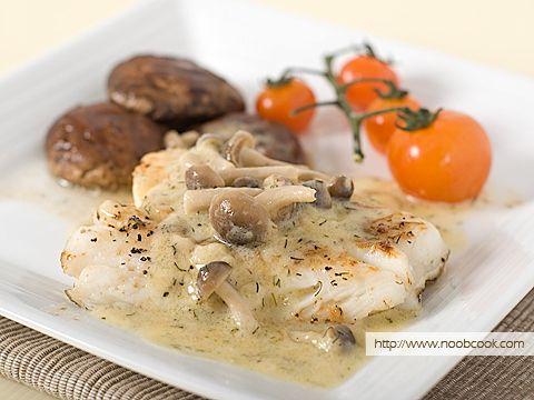 Cod fish with creamy mushroom sauce served with grilled for Creamy sauce served with fish