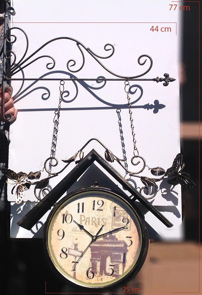 Eskitme Kelebekli Çift Taraflı İstasyon Duvar Saati  Ürün Bilgisi ;  Ürün maddesi : Metal Sessiz çalışır 2 Kalem pil ile çalışmakta Renk : Eskitme Şık ve dekoratif saat Kelebekli olarak tasarlanmış olup şık bir görünüme sahiptir Sevdiklerinize hediye olarak gönderebilirsiniz Çift taraflı olup her iki tarafta aynı tasarıma sahiptir İstasyon saati fotoğraftaki gibidir Ürün Ölçüleri fotoğrafın üzerindedir.