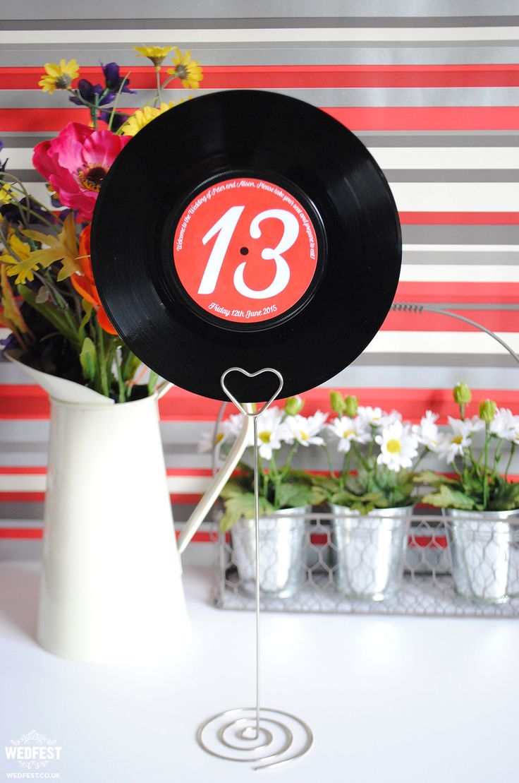 Vinyl Records Wedding Centerpieces http://www.wedfest.co/7-vinyl-record-wedding-table-names-numbers/