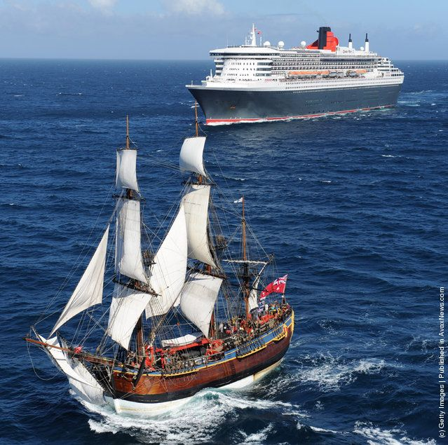 }{ The Queen Mary 2 is saluted by the HMB Endeavour, the replica of Captain James Cook's ship off the coast of Victoria, Australia