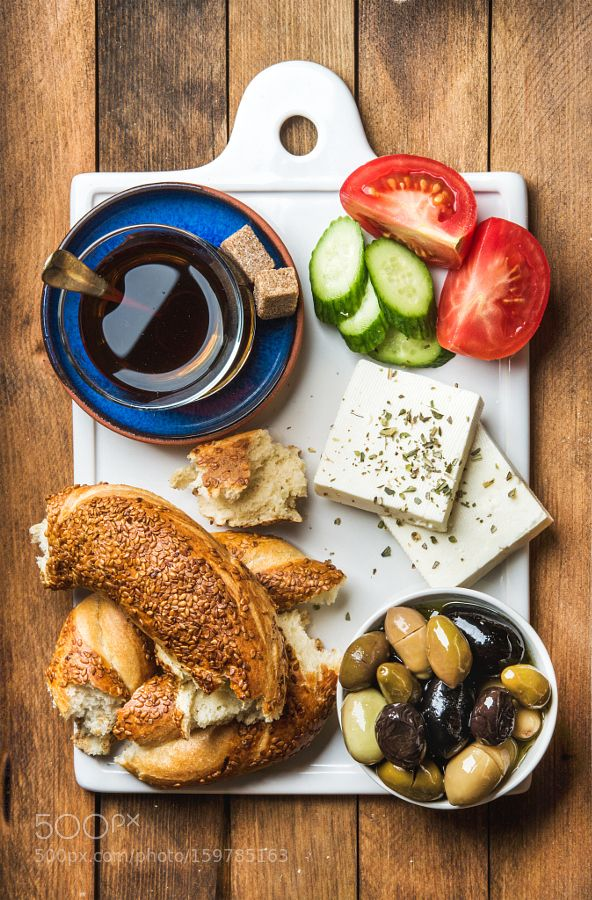 Pic: Turkish traditional breakfast with feta cheese vegetables olives simit bagel and tea