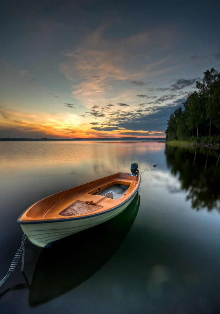 'Orange' boat, sky reflections! In Varmland, Sweden.