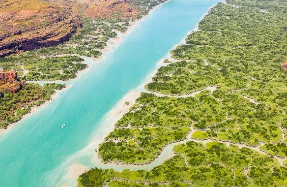 A helicopter trip over the Hunter River in the Kimberley is launched from the beach of Naturaliste Island