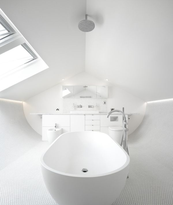 The attic of a 1900′s terrace house converted into a bathroom.
