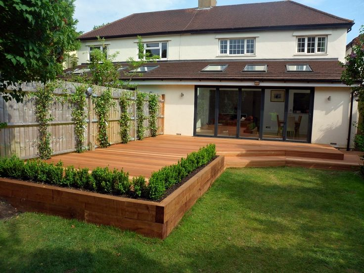 integrate new decking area with raised sleeper fruit beds as here with hardwood deck with railway sleepr raised bed and steps london decking installation