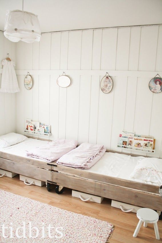 All white room with light pink accents. Love the crate beds on coasters,