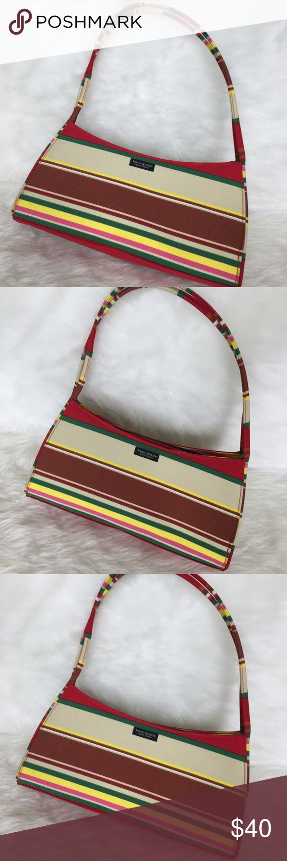 Kate Spade Multi-Stripe Shoulder Bag Super cute and perfect for summer! Excellent pre owned condition, clean inside and out. Top zip closure, inside zip pocket, two handles and red checked lining. Stunning color combination of tan, red, green, pink, rust, and yellow. No Trades. TB1333. kate spade Bags Shoulder Bags