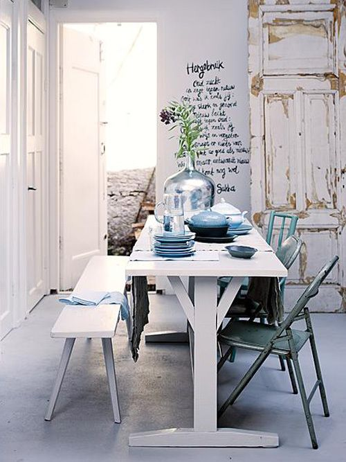 Great (Dutch) text from Sukha on the wall in a bright dining room