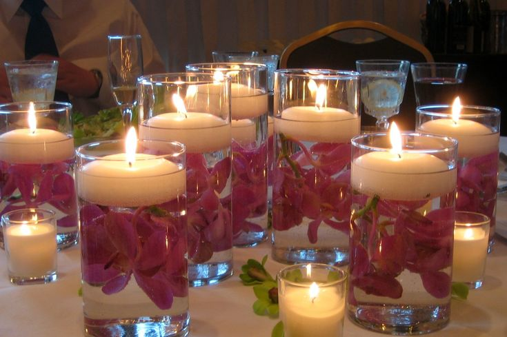 Beautiful flowers and floating candles.  Would look amazing around the bath or in the dinning area.