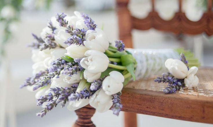 gorgeous bridal bouquet flowers white tulips with purple lavender green stems. so simple and beautiful
