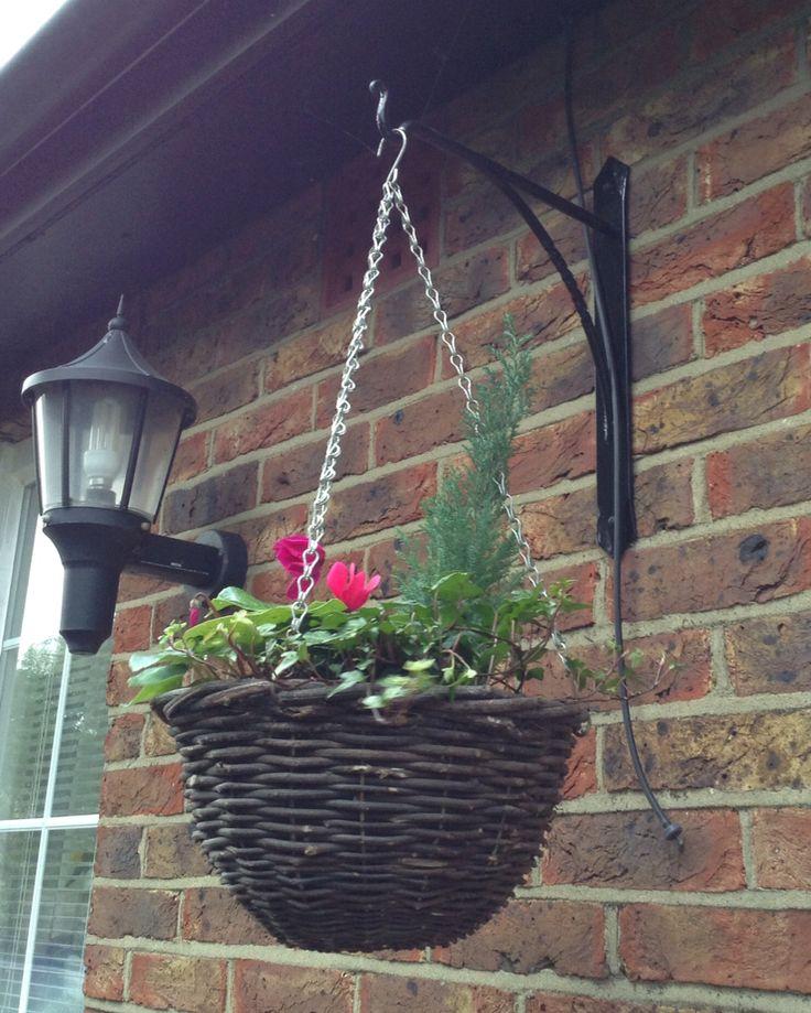 Wrought iron hanging basket bracket