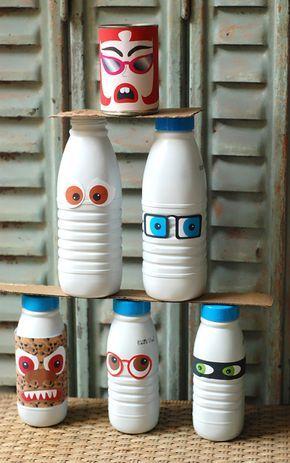 """""""Un jeu chamboule tout à fabriquer avec les enfants ! Pour cela, c'est très simple, prenez des bouteilles de lait, des conserves et télécharger les personnages et yeux rigolos..."""" - Jeu chamboule tout   Mon Bébé Chéri"""