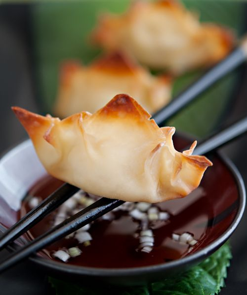 Pineapple Wontons with Togarashi. Use cream cheese, pinapple and green onions. Serve with a spicy sweet sauce.