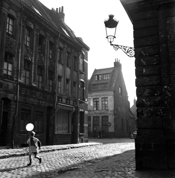 """A hundredth of a second here, a hundredth of a second there — even if you put them end to end, they still only add up to one, two, perhaps three seconds, snatched from eternity."" — Robert Doisneau (from the Weekend Guardian; London, 4 April 1992) • An old district of Lille, France in 1951 by Robert Doisneau • part of 47 images by Doisneau that has never been published; found in the boxes of the Rapho Photo Agency • in celebration of Doisneau's 100th birthday"